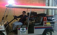 Krista Rawson, Nurse Practitioner, CancerControl Alberta, drives the emergency response cart at the Northlands evacuation centre